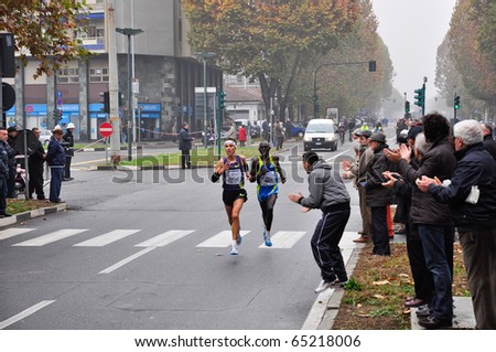 TURIN - NOVEMBER 14: The male winner of the international competition Turin Marathon, Ruggero Pertile, Italy. November 14, 2010 Turin, Italy. - stock photo