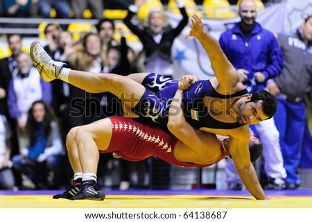 TURIN - OCT 29: Daigoro Timoncini (ITA) fight against AKBARI Moammadreza (IRI) during Wrestling 2010 9th World University Championship, October 29, 2010 in Turin, Italy.