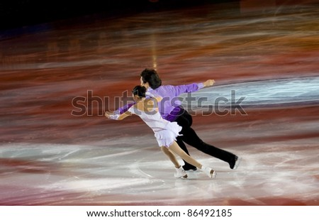 TURIN-OCTOBER  8: Qing Pang and Jian Tong of China perform in the Gran Galà of Ice event in the Palavela, 2011 on October 8, in Turin, Italy.