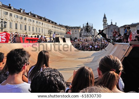 TURIN - SEPTEMBER 12: Skate boarder doing a trick in St. Charles square during the event Turin Street Style. September 12, 2010 (Turin), Italy. - stock photo