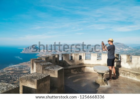 Turist taking picture of landscape in old castle.