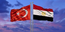 Turkey and Egypt flag waving in the wind against white cloudy blue sky together. Diplomacy concept, international relations.