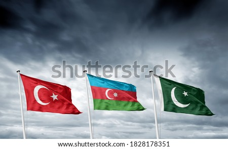 Turkey, Azerbaijan and Pakistan State Flags on grey clouds