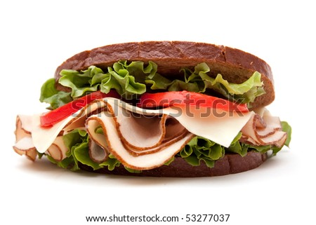 Turkey breast sandwich on rye bread on white background