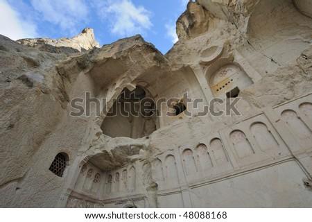 Turkey. Cappadocia. Goreme (Gereme) open air museum. Ruinous christian church against the background of blue sky