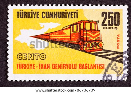 TURKEY - CIRCA 1971:  A stamp printed commemorates regional cooperation between Turkey and Iran on building a railroad link, circa 1971.