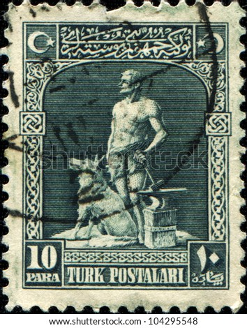 TURKEY - CIRCA 1928: A stamp printed in Turkey shows Legendary Blacksmith and Grey Wolf, Bozkurt, circa 1928 - stock photo