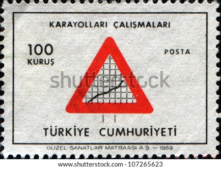 TURKEY - CIRCA 1969: A stamp printed in Turkey shows Road sign and graph Highways, Turkish Economy, circa 1969