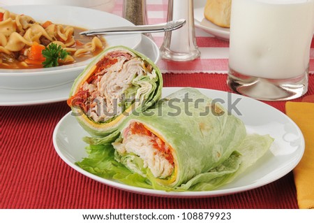Turkey club wrap in a spinach tortilla with vegetable soup