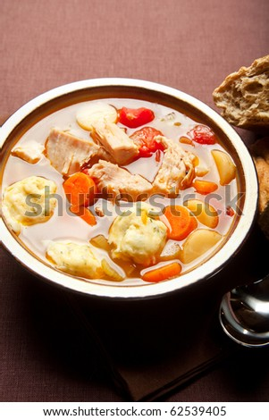 Turkey Dumpling soup with carrot, tomato, and parsnip