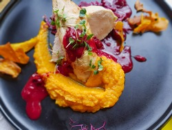Turkey fillet with pumpkin puree with lingonberry sauce and young herbs