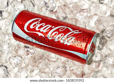 TURKEY - March 25, 2014: 250ml Classic Coca-Cola Can on crushed ice. Coca-Cola is one of the worlds favorite beverages.