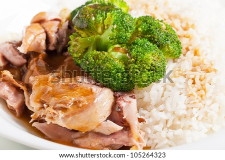 turkey meat topped with steamed broccoli and gravy on a side