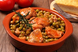 Turkey meat with pea garnish in tomato sauce. Bowl with very delicious food.