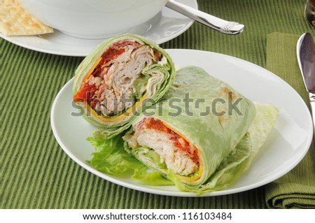 Turkey or chicken wraps with lettuce, cheese and hot pesto sauce