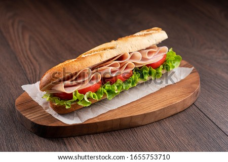 Turkey Sandwich With Tomato And Lettuce Foto stock ©