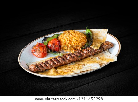 Turkish Adana Kebab, Dark Background, with clipping path included (TR: Adana Kebap ) Stok fotoğraf ©