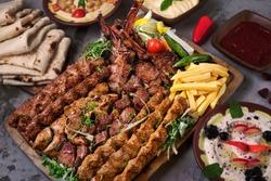 Turkish and Arabic Traditional Ramadan Mix Vali Kebab Plate inside Adana, Urfa, Chicken, Lamb, Liver and Beef on bread