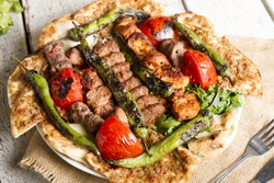 Turkish and Arabic Traditional Ramadan Mix Vali Kebab Plate inside Adana, Urfa, Chicken, Lamb, Liver and Beef on bread and lahmacun.