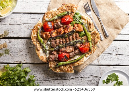 Shutterstock Turkish and Arabic Traditional Ramadan Mix Vali Kebab Plate inside Adana, Urfa, Chicken, Lamb, Liver and Beef on bread and lahmacun.