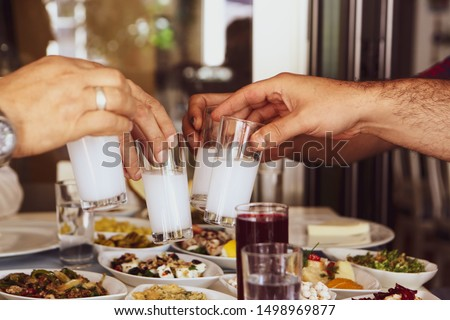Turkish and Greek Traditional Dinning Table with Special Alcohol Drink Raki. Ouzo and Turkish Raki is a dry anise flavoured aperitif that is widely consumed in Turkey, Greece, Cyprus and Lebanon