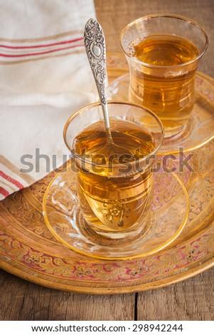 Turkish apple tea a sweet apple flavoured beverage served in Turkish tea glasses