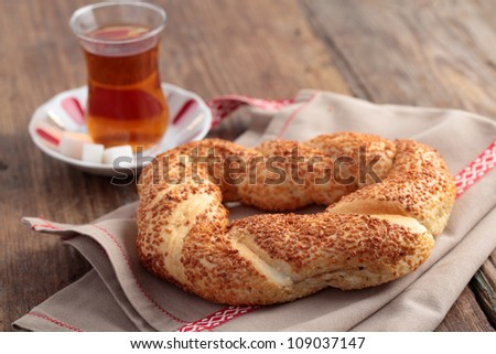 Turkish bagel, simit, and traditional tea on a table - stock photo