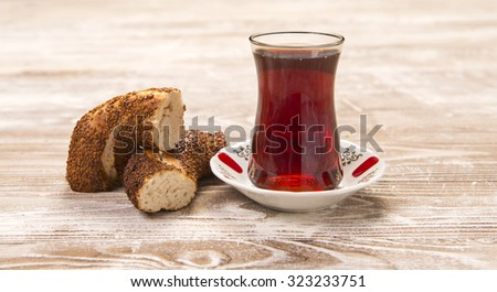 Turkish bagel & Turkish tea in traditional curved glass on wooden table