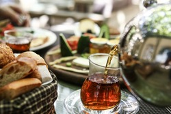 Turkish Breakfast with turkish tea, egg, domatoes, Cucumber, olive, bread and others