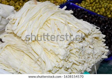 "Turkish cheese: full-fat beyaz peynir (white sheep's milk cheese,Greek feta),yellow kaşar peynir (""kosher"" cheese, Greek kasseri),young, sweet or aged and tangy. cecil, topi, burgu peynir, bazaar Stok fotoğraf ©"