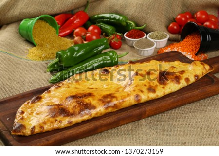 Turkish Closed Pide with Minced Meat Kavurma and cheese - Kapalı Bafra Pide #1370273159