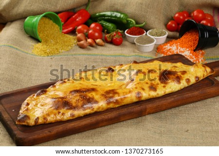 Turkish Closed Pide with Minced Meat Kavurma and cheese - Kapalı Bafra Pide #1370273165