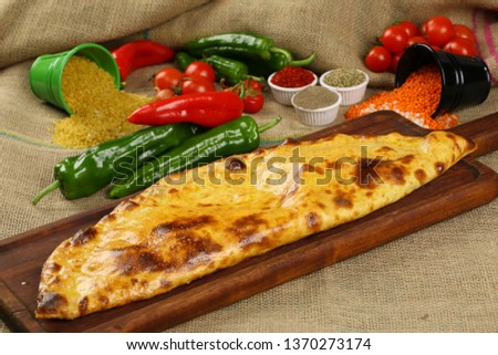 Turkish Closed Pide with Minced Meat Kavurma and cheese - Kapalı Bafra Pide #1370273174