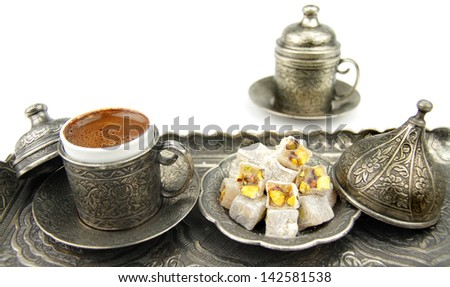 Turkish coffee and turkish delight with traditional metal cup and tray