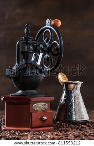 Turkish coffee pot and vintage coffee mill on coffee beans #611553212