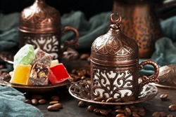 Turkish Coffee served with Turkish Delight, selective focus with shallow depth of field