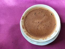 Turkish coffee, turkish coffee in maroon background, frothy coffee