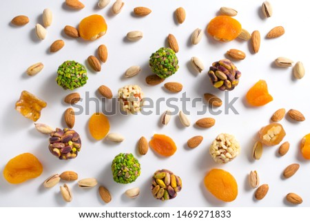 Turkish confectionery. Healthy no sugar snack. Scattered pistachio and almond nuts. Flat lay.