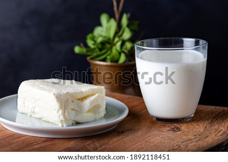 Turkish creamy dairy product. Clotted cream (butter cream) for Turkish breakfast with glass of milk. Stockfoto ©