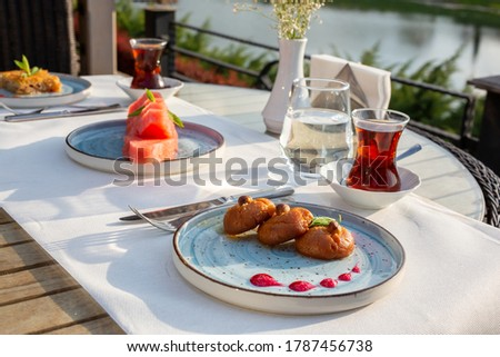 Turkish culture Şekerpare Tatlı, next to tea Stok fotoğraf ©
