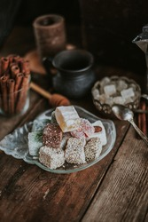 Turkish Delight - a gelatinous sweet confection traditionally made of syrup and cornflour, dusted with icing sugar. Still life - oriental sweet rahat lokum . Candy marshmallow.