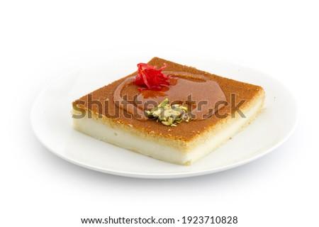 Turkish dessert kunefe, kunafa, kadayif with pistachio powder and cheese, served hot, very sweet. Turkish traditional dessert.Lebanese dessert of Kunafa isolated on white