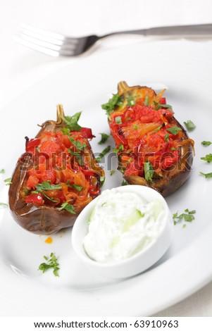 Turkish dish Imam bayildi with cacik
