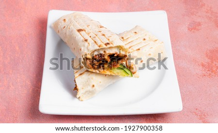 Turkish durum with beef in white plate isolated on pink. Stok fotoğraf ©