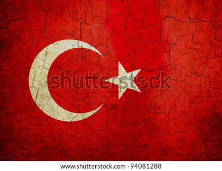 Turkish flag on a cracked grunge background