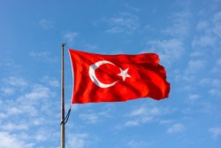 Turkish Flag on cloudy sky background. 19 mayis, 23 nisan, 15 temmuz, 30 agustos, 29 ekim, 10 kasim. Turkish nation. 19 may, 23 april, 15 july, 30 august, 29 october.
