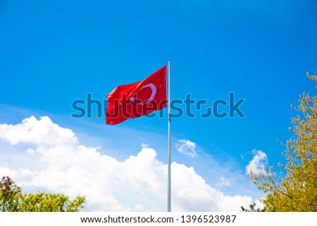 Turkish flag waving at blue sky. Turkey country flag flowing in the wind at blue sky.  #1396523987