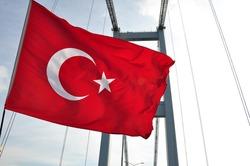 Turkish flag waving on istanbul bosphorus bridge
