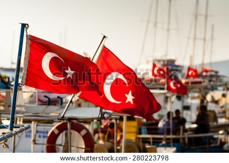 Turkish flags on boats moored at Bodrum, Turkey.