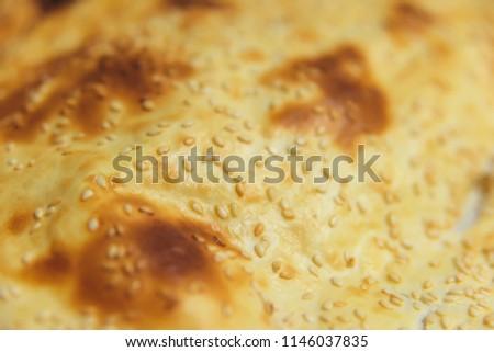 Turkish flat cake with sesame seeds. Turkish fast food. Baked scone. Ramazan Pidesi Tarifi #1146037835